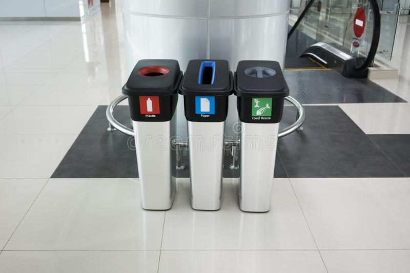 Three trash cans in the airport stock image