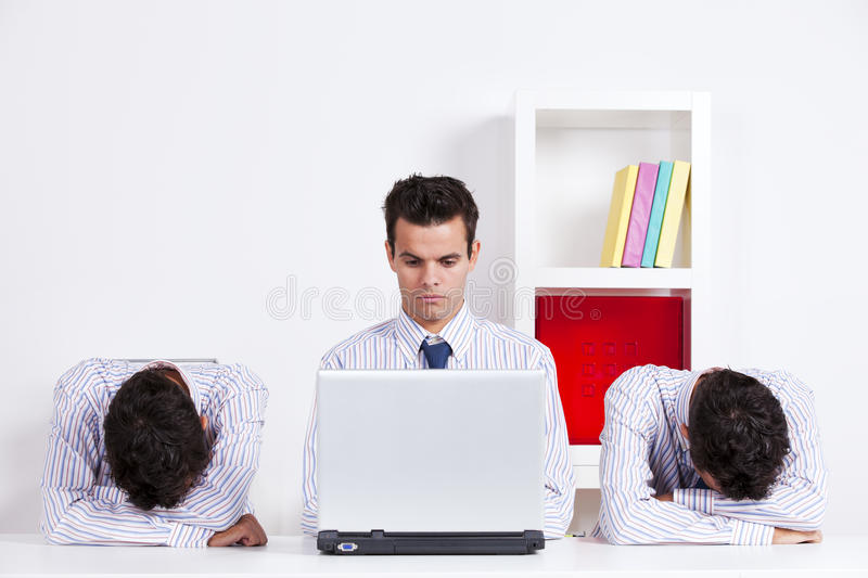 Three twin businessman at the office royalty free stock photography