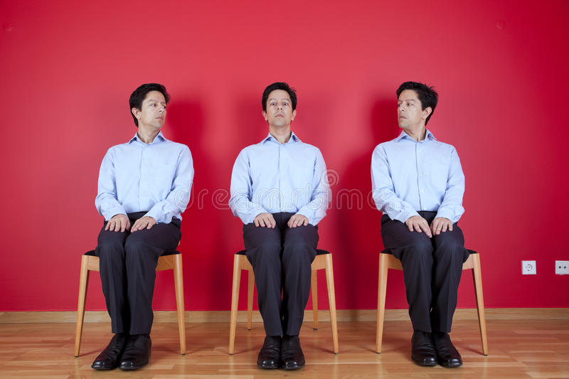Three twin businessman waiting stock image