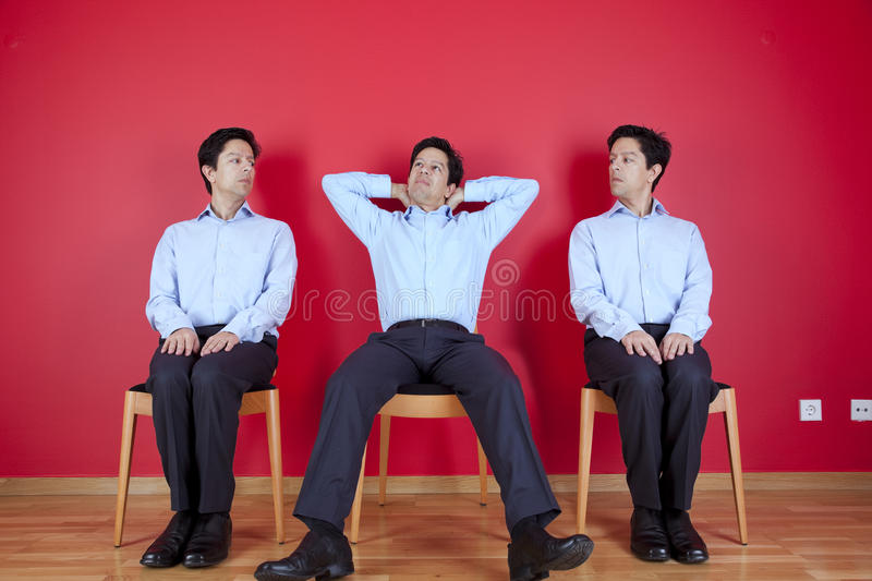 Three twin businessman waiting royalty free stock images