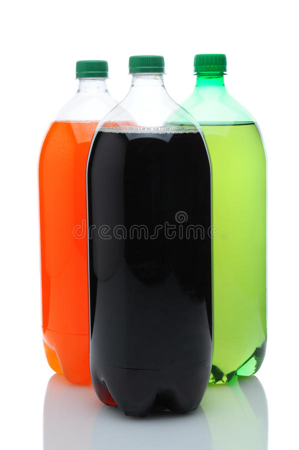 Three Two Liter Soda Bottles Over White. Three plastic two liter soda bottles with reflection. Vertical format over a white background stock photography