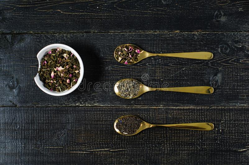 Three types of tea in spoons - green, black and Rooibos stock photo