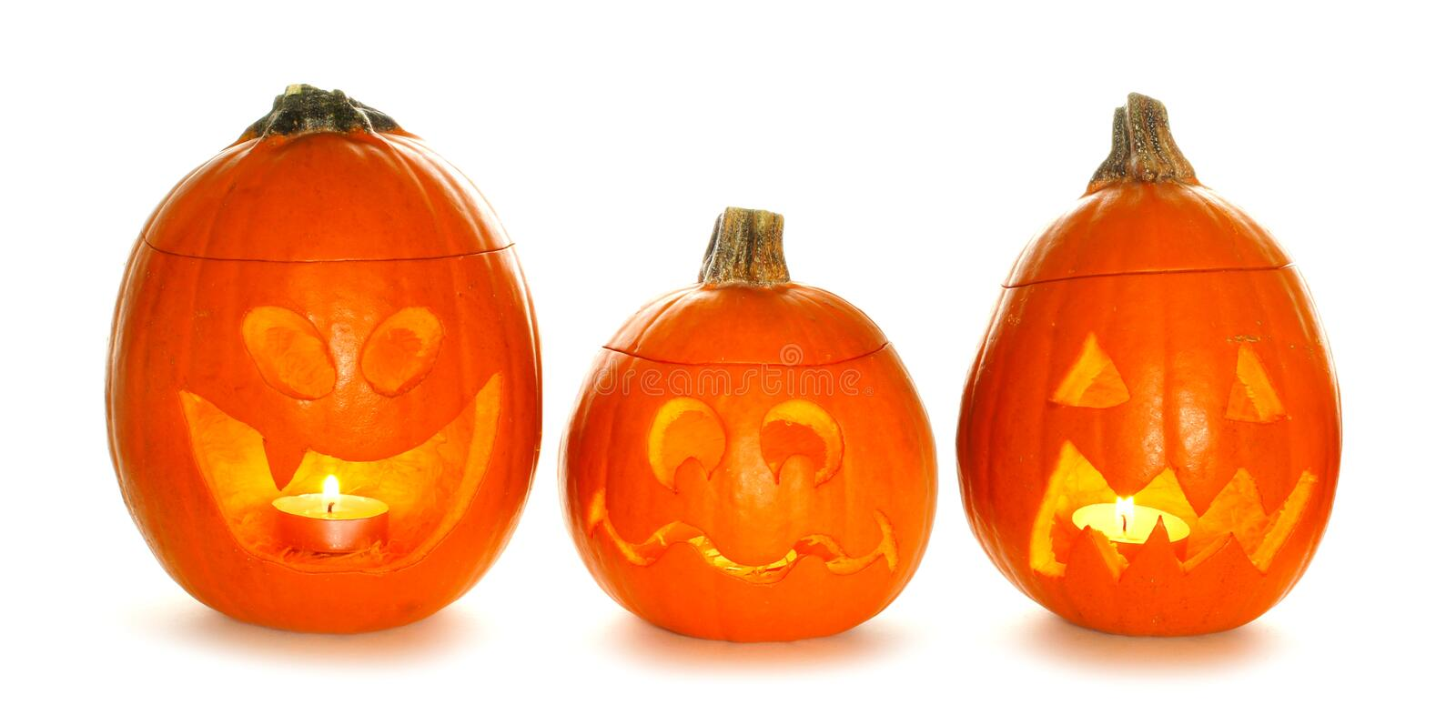 Three unique Halloween Jack o Lanterns isolated on white royalty free stock photography
