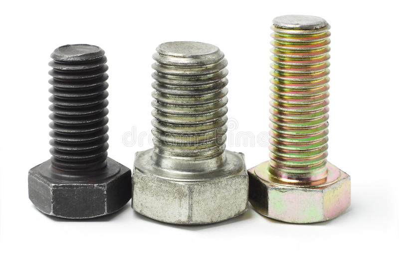 Three used bolts. Arranged on white background royalty free stock photos