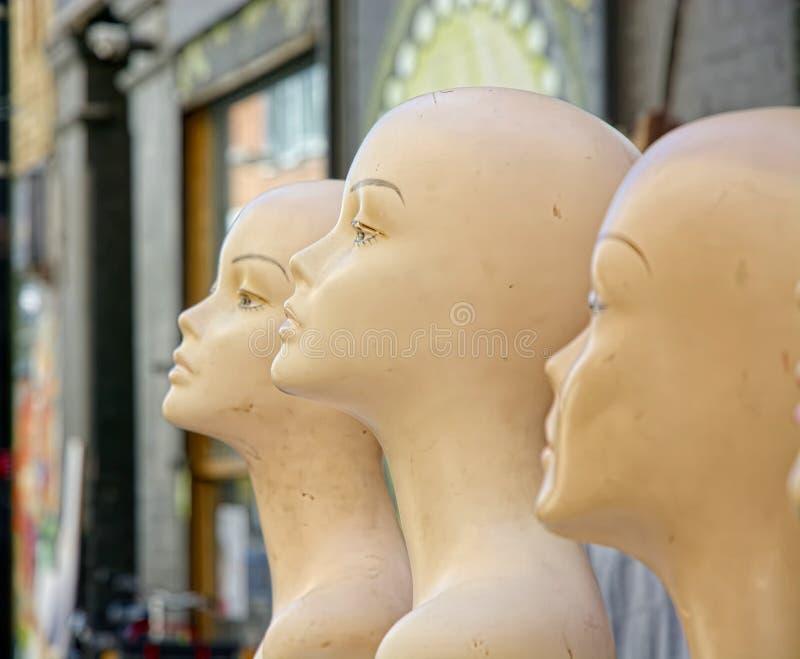 Retro Female fashion mannequin heads stock images