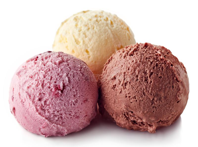 Three various ice cream balls - strawberry, vanilla and chocolate royalty free stock photos