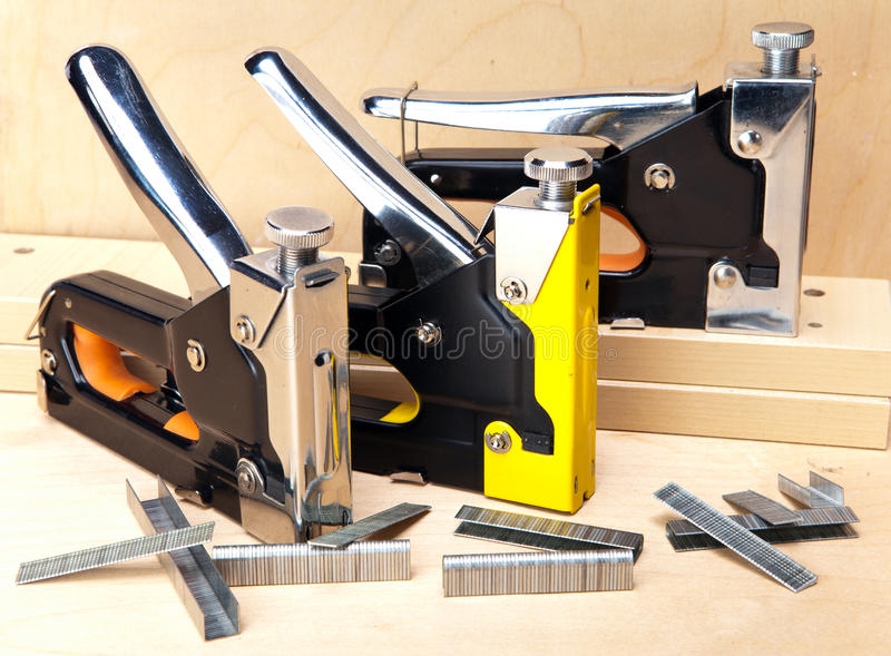 Three various metal stapler for repair work in the house royalty free stock image