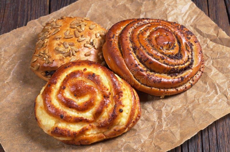 Three sweet buns royalty free stock photos