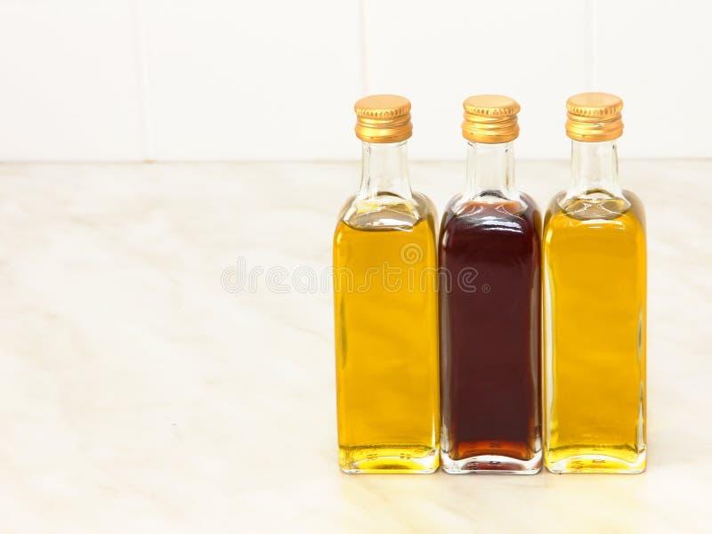 Download Three Vegetable Oil Bottles On White Kitchen Table. Stock Photo    Image: 51554271