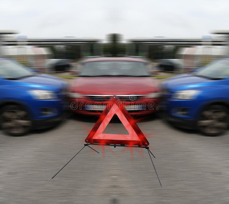 Three vehicles after a car accident. In the foreground a warning triangle royalty free stock photography