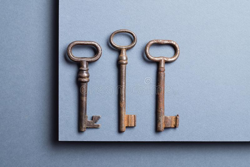 Vintage Key. Three Vintage Keys over dark background, top view with negative space royalty free stock photos