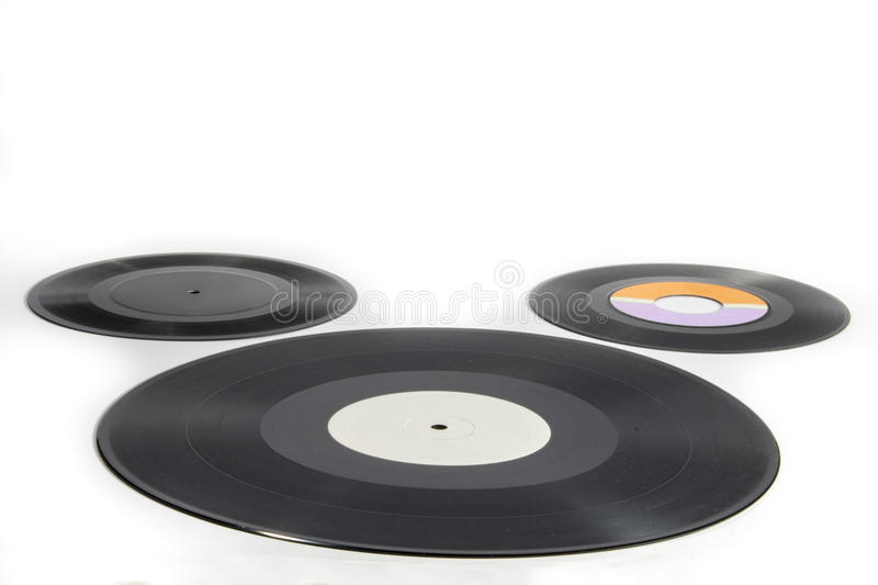 Three vinyl records of different sizes on white background royalty free stock images
