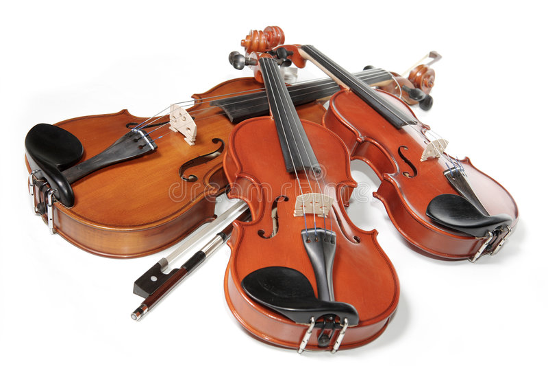 Three violins royalty free stock photos