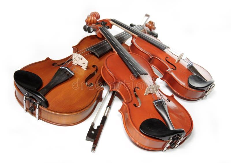 Three violins stock photo