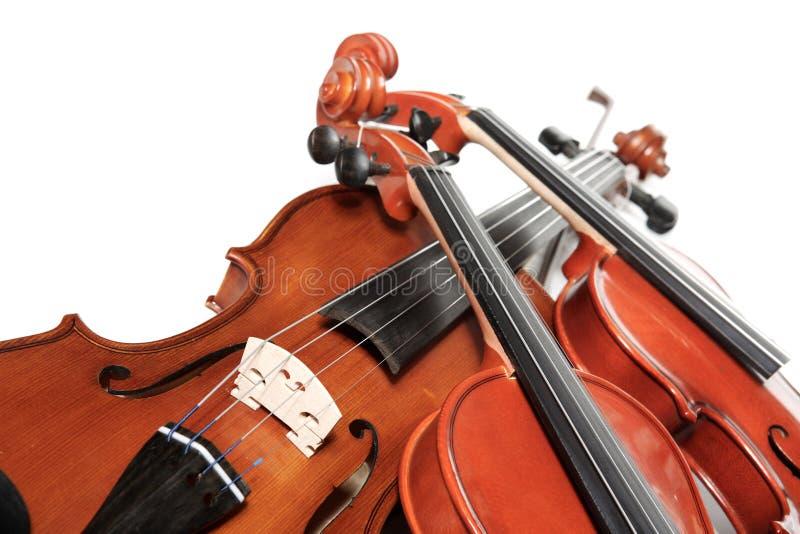 Three violins stock photos