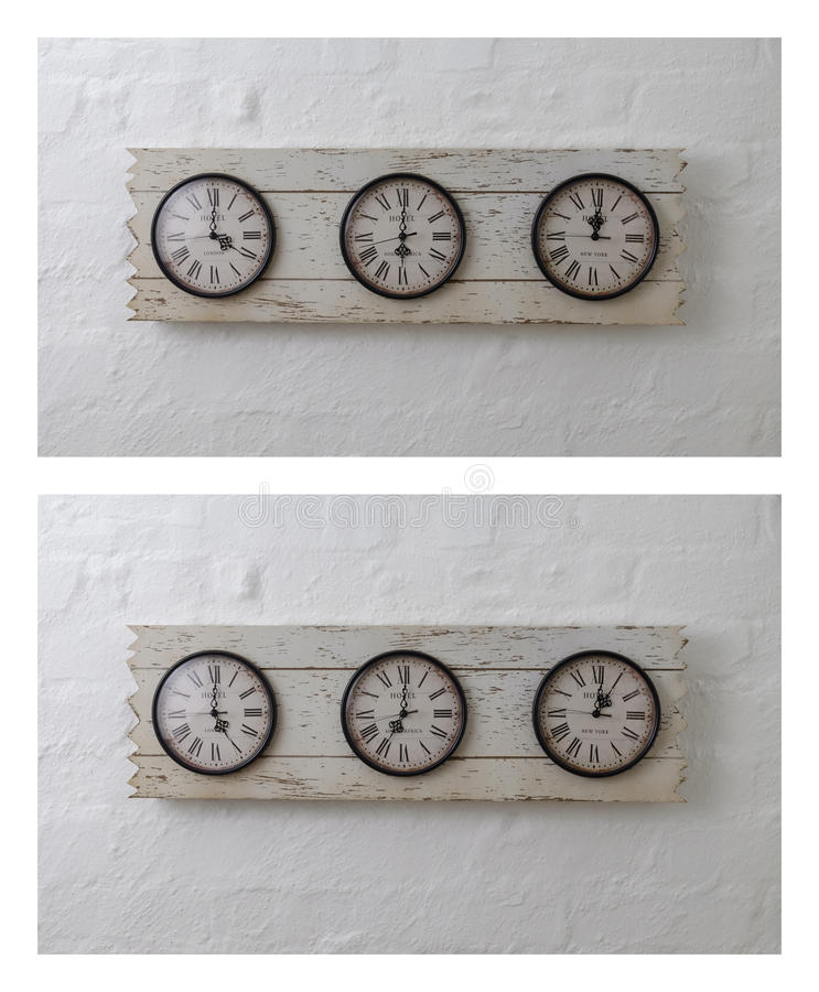 Three wall travel clocks in different time zones royalty free stock photography