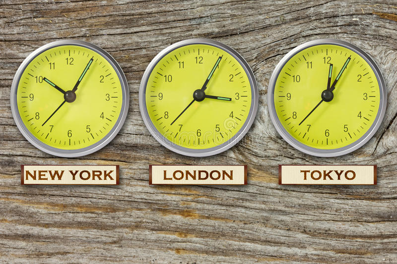 Download Three Watches On Wooden Wall Stock Image - Image: 26086253