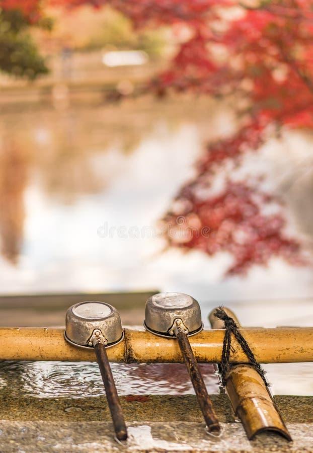 Three water ladles on purification basin in the inokashira park of Kichijoji city in autumn royalty free stock photos