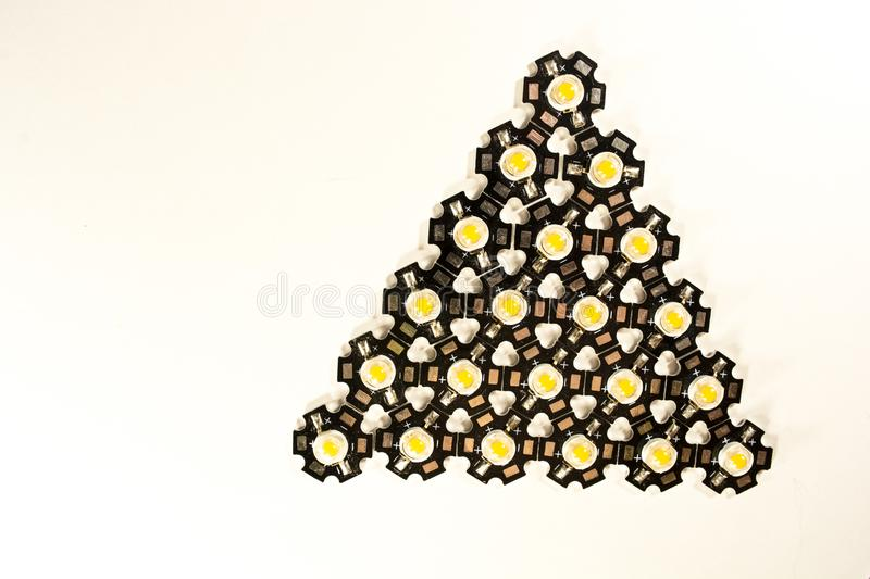 Three watt LEDs on a light background.LEDs for plants. Bud cannabis plants under the LED modern lighting of the full spectrum indoors and in a greenhouse royalty free stock photo