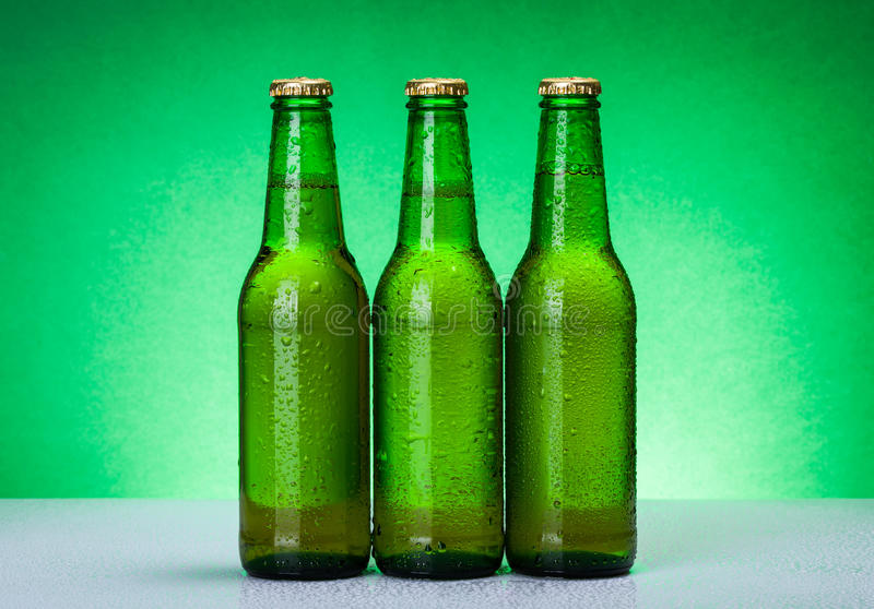 Three wet blank beer bottles stock images