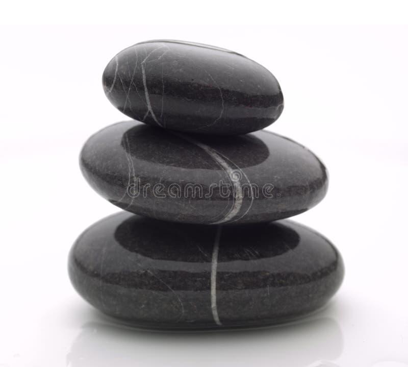 Three wet stones stock photo
