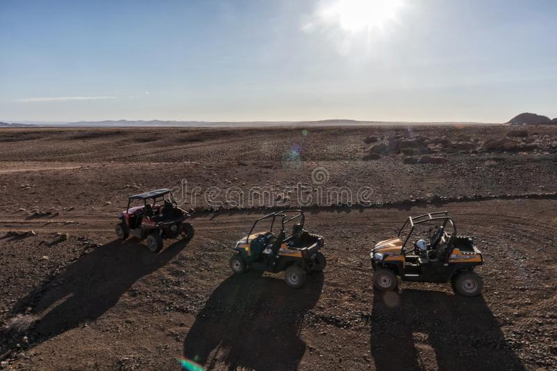 Three-wheeled all-terrain buggy, overlooking the arid landscape of Sesriem, Namibia. Africa royalty free stock image