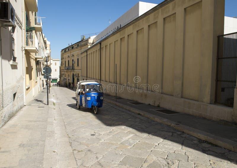 Three wheeled Ape Calessino tour vehicle in Matera, Italy. stock image