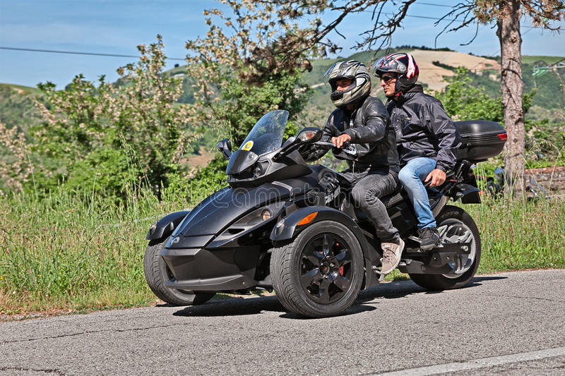 Three-wheeled BRP Can-Am Spyder. Biker riding three-wheeled vehicle BRP Can-Am Spyder Roadster in motorcycle rally Mototagliatella on May 10, 2015 in Predappio stock photography