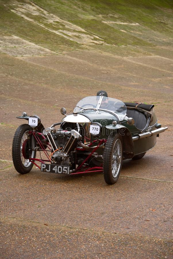 Three wheeled Morgan Super Sport car on the curved banking of Brooklands racetrack. Surrey, England. royalty free stock image