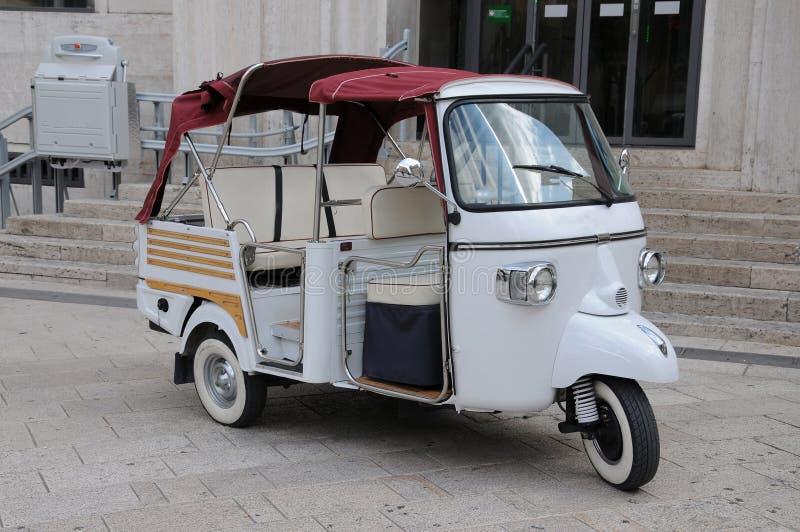 Three wheeled motorbike. Three wheeled transportaion cab for sightseeing in Matera, Puglia, Italy stock photos