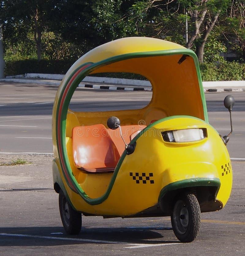 Three Wheeled Taxi In Havana Cuba. Yellow three wheeled taxi in Havana Cuba stock photography
