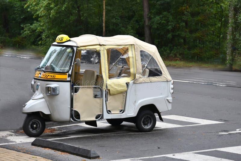 Three wheeled tuk tuk taxi stock image