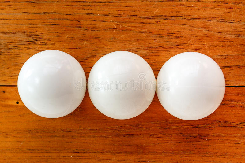Three white balls of billiard. Over wooden board royalty free stock photography