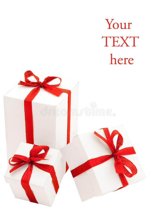 Three white boxes with red bows stock photo
