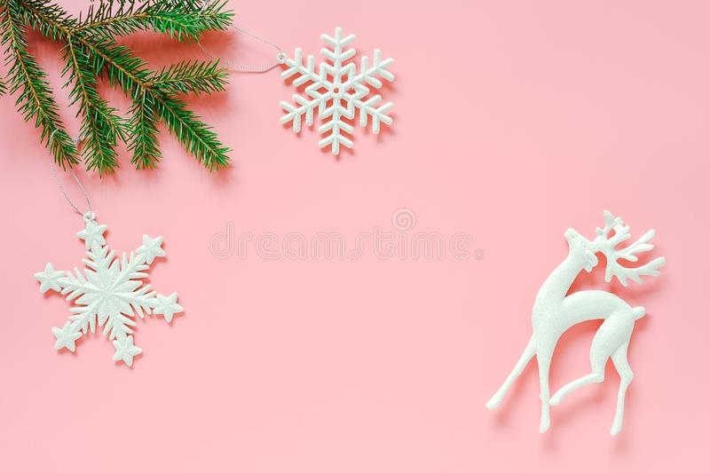 Three white christmas decoration tree toy on fir branch on pink background copy space. Concept Merry christmas or Happy new year. Minimal style Top view Flat royalty free stock photos