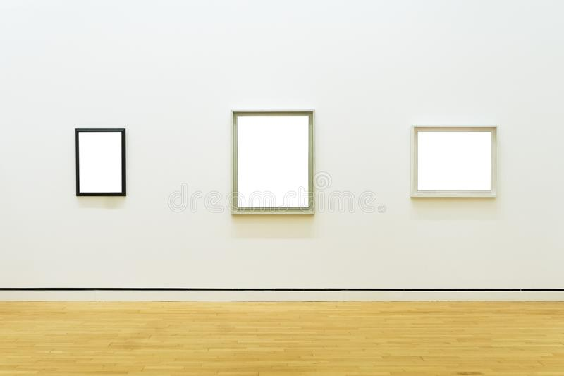 Three White Clipped Paintings Hung On A Clear Wall. Stock Photo ...