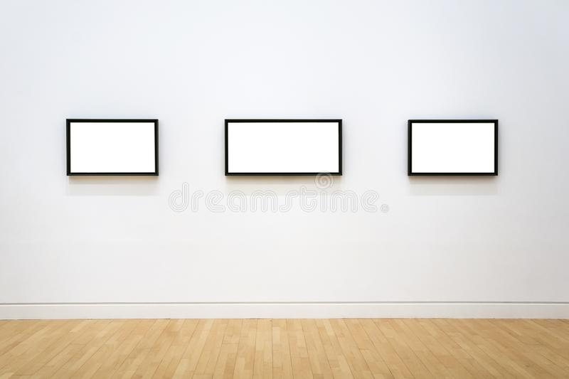 Three White Clipped Paintings With Wooden Frames Hung On A Clear ...