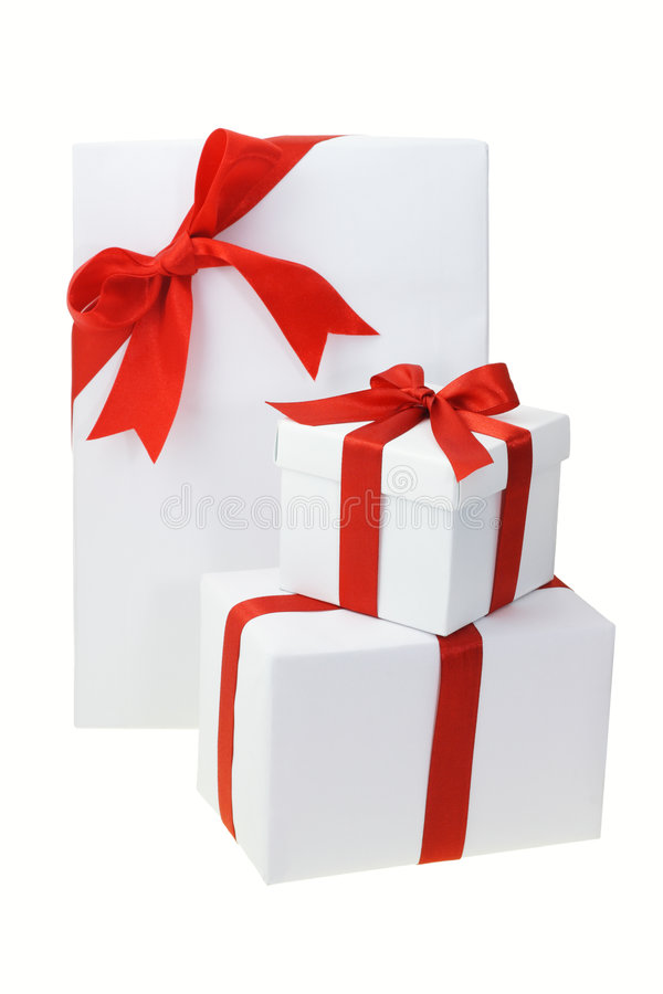Three white gift boxes. With red bow ribbons on white royalty free stock photo