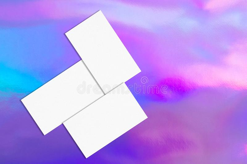 Three white rectangle business card mockups on holographic background vector illustration