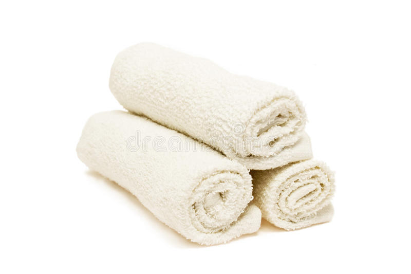 Three white towels. Three white soft towels on white background royalty free stock images