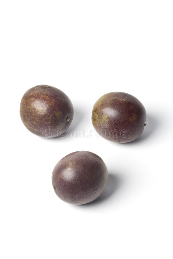 Three whole passie fruit stock photos