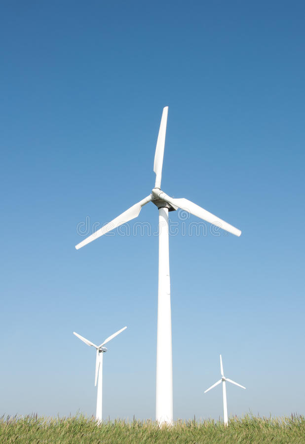 Three wind turbines stock photos