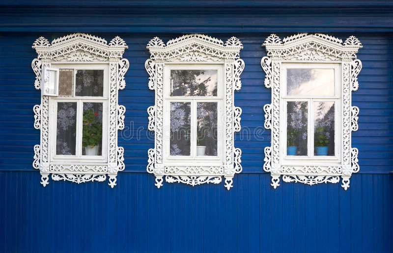 Three windows. From old wooden rural wall royalty free stock photography