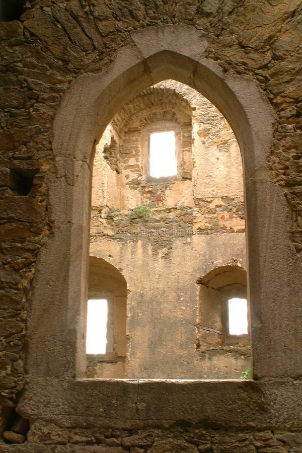Three Windows through Arch stock images