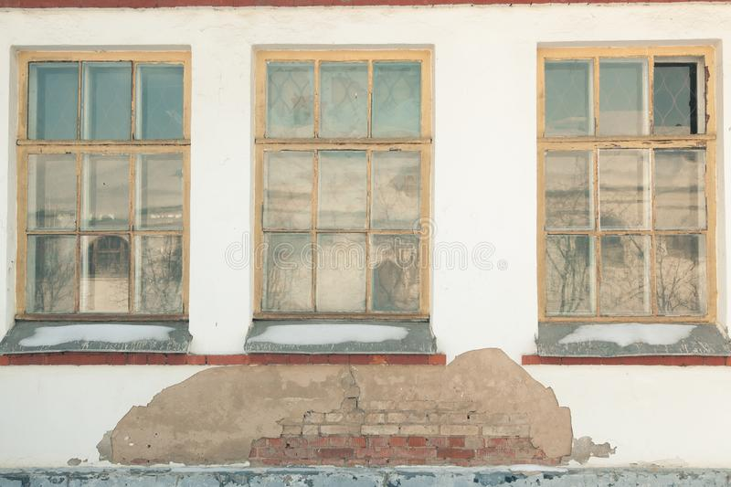 Three windows of old house stock images