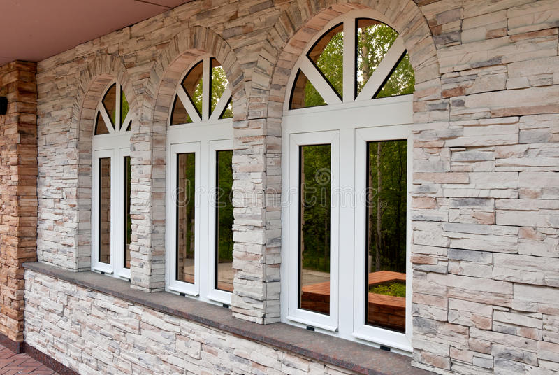 Three Windows In The Stone Wall Stock Image