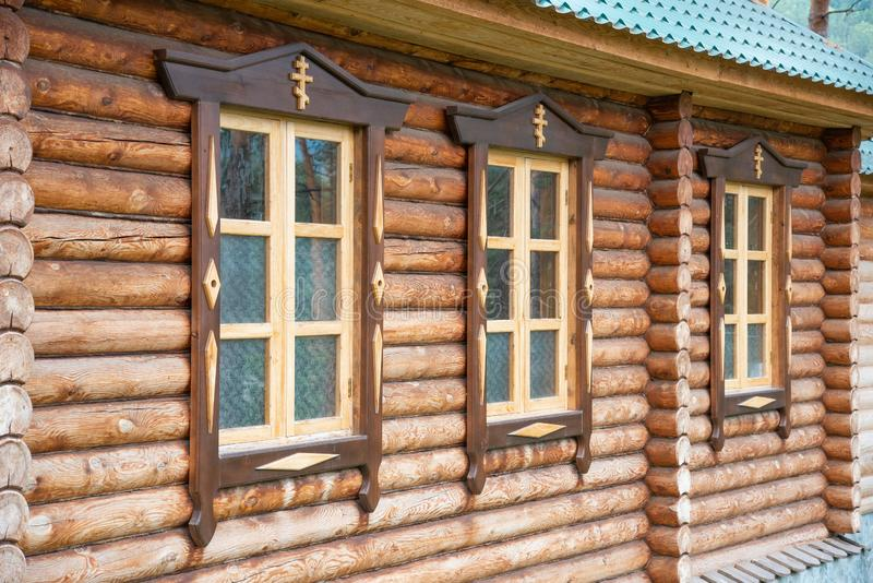 Three windows of the wooden orthodox church. stock photos