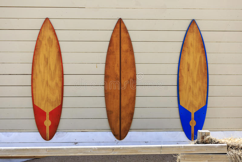 Three windsurf tables on the wall.  stock photos