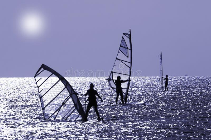 Three windsurfers stock photography