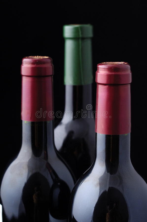 Three Wine bottles royalty free stock image
